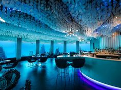 Located nearly 20 feet below the Indian Ocean, Subsix earns bragging rights as the world's first underwater club. The floor-to-ceiling windows lining the walls of the bar provide spectacular night views of the illuminated ocean floor. More than 545 yards from the coast, Subsix is only accessible by boat.  Related: An Eco-Friendly Getaway in the Maldives