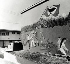 Mural painting with UFW flag :: Latino Archives