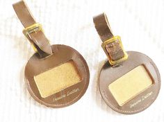 Remember luggage tags were made of leather, not plastic. Luggage Tags Leather Brown Vintage Round Set by HerbgirlAndVintage,