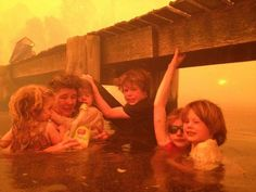 Australian family forced to take shelter in sea as wildfires tear through Tasmania, destroying their beach-side home