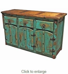 This Mexican Colonial style painted wood buffet, with extra thick doors and drawers, is accented with braided iron hardware and nailheads. This Mexican buffet will enrich any southwest or rustic decor with its colorful antique look. Cheap Living Room Furniture, Wood Buffet, Painted Furniture, Rustic Furniture, Furniture Collection, Recycled Furniture, Mexican Furniture, Mexican Furniture Plans, Western Furniture