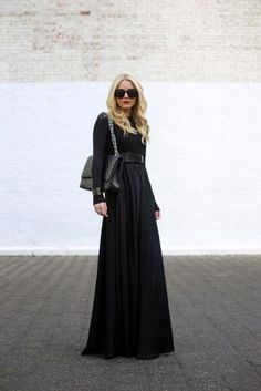 What to Wear to a Fall Wedding: 14 Looks You'll Love | Divine Caroline. I had never thought of a dark colored, long sleeve maxi for a wedding. I absolutely love this idea!