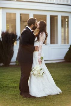 Bride and groom sharing such a sweet kiss at their tented wedding   www.christianOthStudio.com