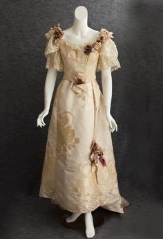Ball Gown: ca. 1895, chiffon damask overlay on bodice, lined with silk taffeta, both pieces embellished with ribbons and fabric flowers.