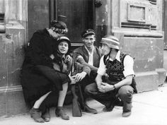 Members of the Polish Home Army and Polish Resistance take a break in the battle during the insurgency and share a quiet moment on a doorstep during the Warsaw Uprising. The uprising would last just. Poland Ww2, Warsaw Poland, Warsaw Ghetto Uprising, Home Guard, Military Photos, Red Army, Women In History, World War Two, Historical Photos