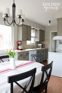 Blended light neutrals -- putty cabinets, creamy tan counters/backsplash, light walls, white appliances