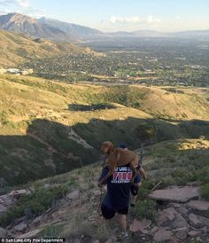 This is the heartwarming moment one firefighter placed an injured dog on his shoulders and carried her two miles to safety through the Utah mountains