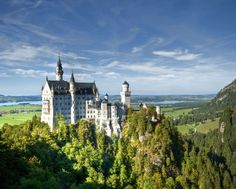 Schloss Neuschwanstein, Bavaria, Germany - It's hard to credit that Bavaria's 'mad' King Ludwig II never clapped eyes on Disneyland. The Wagner-loving royal, obsessed with romantic epics of knightly lore, created castles of stereotypical fairytale grandeur. His apotheosis came with Neuschwanstein, started in 1869 atop a wooded outcrop: witch-hatted turrets, Minstrels' Hall, grand throne room - all that's missing is a wicked sorcerer and perhaps a distressed damsel incarcerated in a tower.