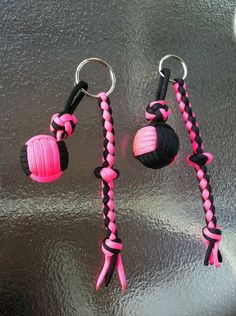 http://www.paracordist.com Paracordist how to TIGHTEN a two color monkey's fist knot made with paracord and a jig #paracordist #paracord #preppers #survivalist #550cord