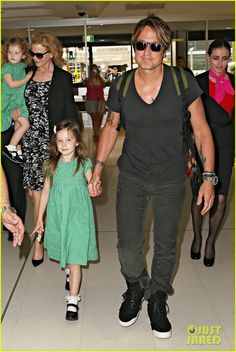 Nicole Kidman and Keith Urban head into the airport to catch a flight out of the country on Thursday (January 2) in Sydney, Australia. The 46-year-old actress and the 46-year-old singer were joined by their daughters Sunday, 5, and Faith, 2. The family has been in Sydney for the past couple weeks to celebrate the holidays with their loved ones