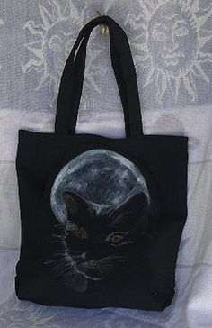 This bag is hand painted by myself with permanent fabric paint. It measures 13 inches across and 13 ½ inches long. The strap measures 20 inches in total length.I t can be laundered like all of my designs in side out in the washer and dryer low heat.