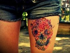 flower skull tattoo. I don't want this, but it's so unique.