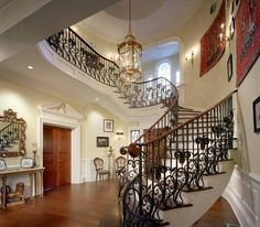 Traditional Staircase with High ceiling, Wall sconce, Hardwood floors