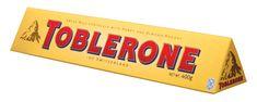 Communication: image d'une montagne qui fait penser au pays du chocolat: la Suisse. Donne un certain prestige au chocolat. De plus, la montagne rappelle la forme du produit. Se distingue des autres chocolats par sa forme qui sort de l'ordinaire: pas une plaquette mais un triangle; ce qui va attirer plus facilement l'oeil du consommateur en rayon.  Enfin, la couleur rouge de l'écriture est imposante et intriguante pour le consommateur.