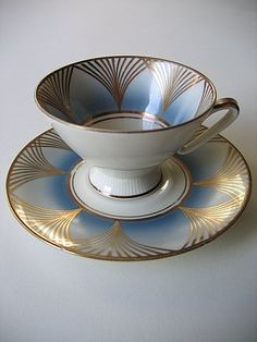 art deco cup & saucer, love everything about this the shape the colour would love a cup of tea from it I'll bet it would taste delicious