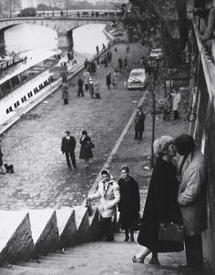 """Ms. Joanne Woodward and her husband, Mr. Paul Newman, exchanging a kiss in Paris during shooting of the 1960 film """"Paris Blues""""."""