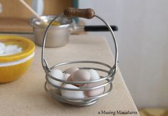NEW Bail Handled Country Egg Basket with Dozen Farm Fresh Eggs in 1 Inch Scale for Dollhouse Miniature Kitchen. $15.00, via Etsy.