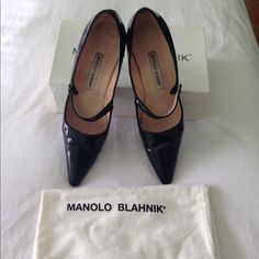 Manolo Blahnik Mary Janes Patent leather Mary Janes. The elusive fashion urban legend as appeared in Sex and the City. The only damage to these shoes is pictured in 4th picture. Knick in the leather on the heel. Can easily be fixed by a good shoe maker. Manolo Blahnik Shoes