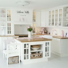I love white kitchens!