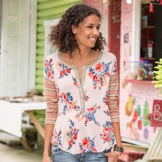 "GARDEN SPIRIT HENLEY -- Playful mixed prints bring a smile with stripes and florals in soft-to-the-touch jersey knit fabric. Raw-edge details. Rayon/polyester/cotton/viscose. Hand wash. Made in USA of imported fabrics. Exclusive. Sizes XS (2), S (4 to 6), M (8 to 10), L (12 to 14), XL (16). Approx. 26""L."
