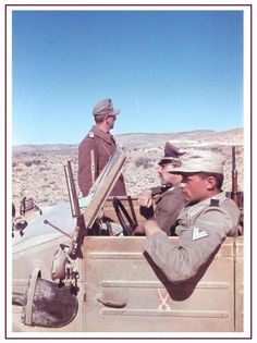Afrika Korps General with his staff in their Kubelwagen in the western desert. Can anyone name this General?