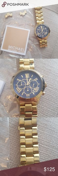 Michael Kors watch Gold and navy face Michael Kors watch.  Extra links included.  Gently worn. Instruction book included. MICHAEL Michael Kors Accessories Watches