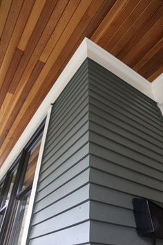 We're very proud of the level of detail on this project. Cedar mitered bevel corners, crown molding and soffits come together elegantly. Stain front door same as ceiling House Paint Exterior, Exterior Siding, Exterior House Colors, Exterior Design, Gray Siding, Shiplap Siding, White Siding, Exterior Remodel, Exterior Paint Colors