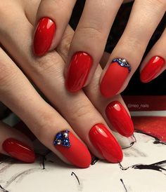 Combination of shiny and matte red is very nice and blue rhinestones give extravagant note.