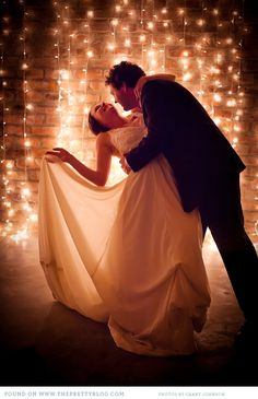 WEdding photo, dance dip the lights in the background are gorgeous