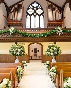 The ceremony took place at the First (Park) Congregational Church in Grand Rapids, Michigan—Cassandra's family church. Staying true to the bride's love for green and white arrangements, event designer David Stark used florals that fit the bill: giant dahlias, Dutch hydrangea, California garden roses, Dutch snowberry, and cascading dendrobium from Hawaii, to name a few.