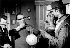 Sergio Leone on the set of A Fistful of Dollars directing Clint Eastwood.