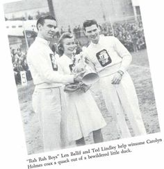 Puddles (the live duck kept as a mascot by UO students until 1946) is held by Oregon cheerleaders in 1940.  From the 1941 Oregana (University of Oregon yearbook).  www.CampusAttic.com