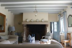 "Complete redecoration for this country retreat on the Normandy Coast, which inspired the soft palette of sand and sky blue. The walls are painted in Farrow  Ball's ""Matchstick"", while the beams are in ""Light Blue"" and the other paintwork is in ""Oval Room Blue""."