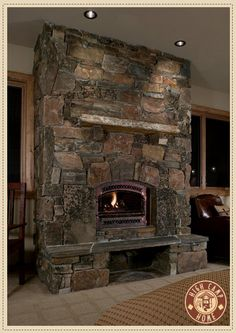 Example for airtight wood stove mounting; flat rock stone fireplace. High Camp Home Interior Design