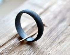 34 Unconventional Wedding Band Options For Men | Oxidized Black-Grey Band, $79