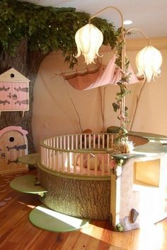 Eclectic Kids Bedroom with Fairy Land Crib, Radiance Lighting Tall Curved-Stem Faith Lamp, Hardwood floors, Crown molding