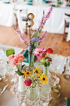 Colorful flowers in several vases - so cute! #wedding #centerpiece #farmhouse #barnwedding #flowers