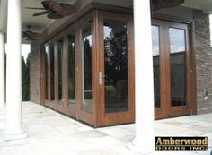 This stunning Amberwood flat sawn white oak true 90 degree Panoramic TM folding door, allows you to bring the outside in!