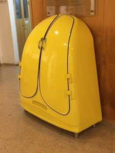 Yellow beetle cabinet Made from a real VW beetle hood. Ronen Tinman #car #furniture #recycle #functionalart #art #design #mancave