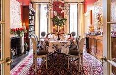 This Top Designer's Holiday Hosting Tips Are the BEST -- Chic, collected, and meaningful are the underlying principles of an Alessandra table. Here, she started with a beautiful embroidered toile fabric she designed for Schumacher as a tablecloth, then topped it with white-on-white place settings that include plates by Astier de Villatte and oversize antique napkins embroidered with her initials. For that meaningful, personal touch—and that glint of Christmas shine—she mixed vintage…