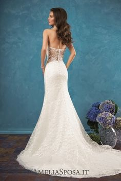 Wedding dress Ariana - AmeliaSposa.  To create a sensual look put an accent on laces and body-clinging silhouette. Original design solutions such as a provocative naked back, American armhole and openwork elements focusing on a bride's waist, will add some spices to the wedding romantics.