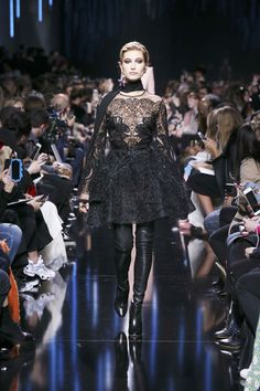 Black beaded embriodered mini dress from the Elie Saab Ready-to-Wear Autumn Winter 2017-18 Collection. Team this outfit with black leather thigh boots, you have on sexy look to slay the night.