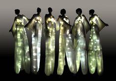 Stilt walkers with light-up costumes Stilt Costume, Sea Costume, E Textiles, Inspiration Artistique, Wedding Venue Decorations, Wedding Themes, Night Circus, Fairy Lights, Costume Design