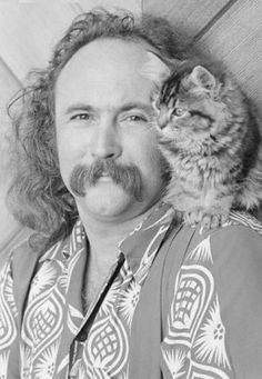 David Crosby hangs out with a fluffy kitten.