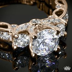 This beautiful 3 Stone Engagement Ring is from the Verragio Paradiso Collection. It features a Lumino Set for both the center and side diamonds and holds 1.00ctw of Round Brilliant