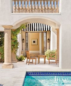 White and Cream Spanish-Style Poolside Sitting Area