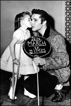 Elvis posing with a polio child for March of Dimes -