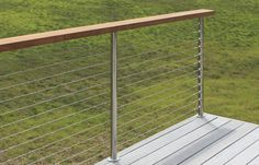 no yellow jacket nests between the posts with this railing!    Cable Railing with Wooden Handrail