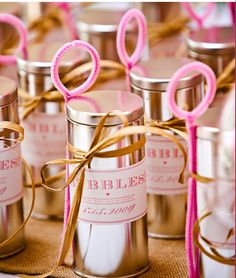 Bubbles for a wedding reception send off.  Made from silver tins, white labels with printed pink font, plus twine holding the plastic bubble wand.  #celebrate  #event  #party