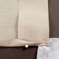 To include a facing in the hem, trim to reduce the facing's bulk, and use a stabilizer at the corner.
